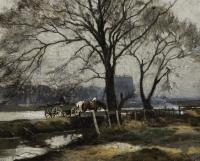 View of horses pulling a green cart along a river.