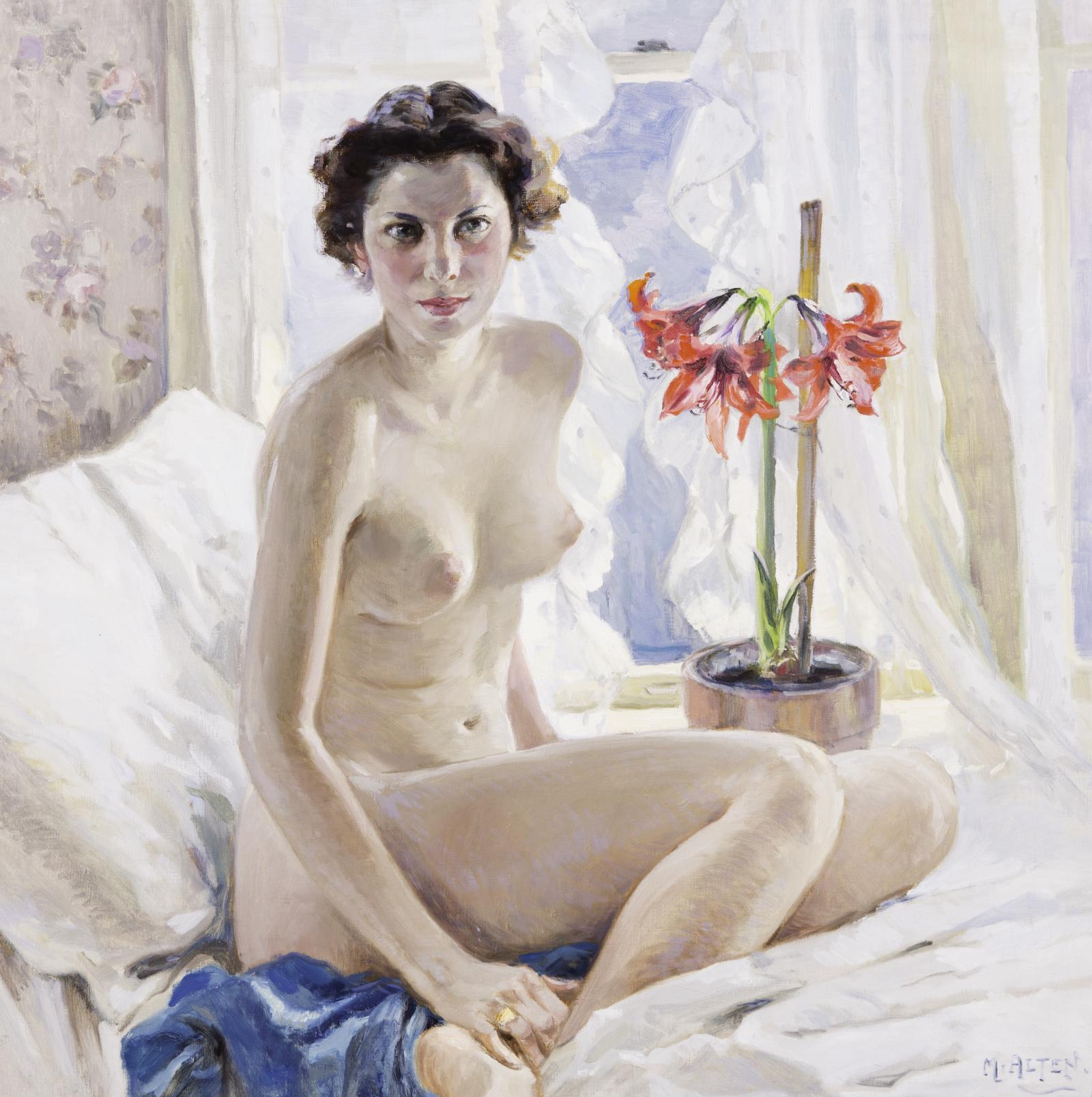 Nude brunette with Amaryllis flower seated upon white bed.