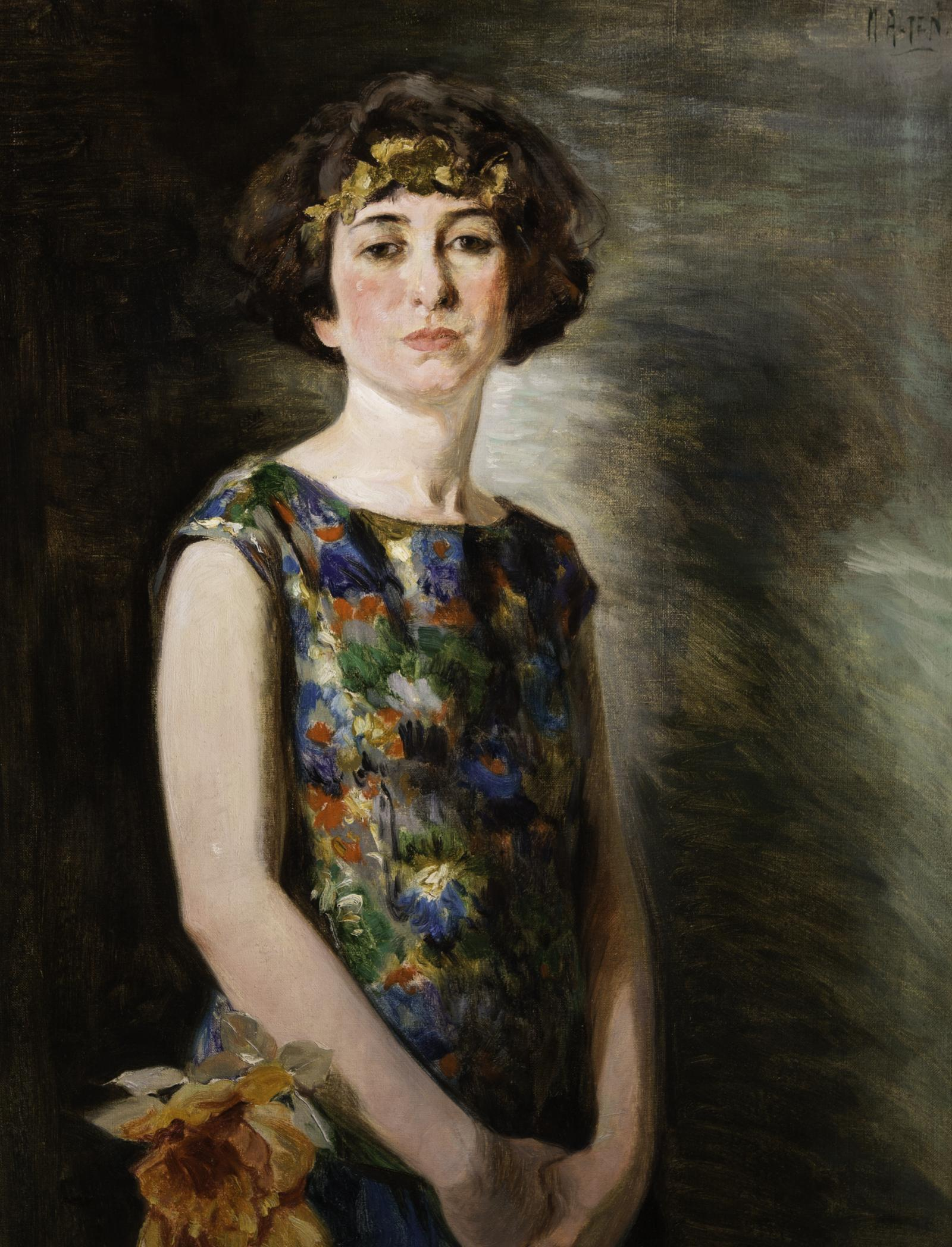 Woman with colorful dress; orange flower by her right hip.