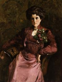 Portrait of a woman sitting in a chair.