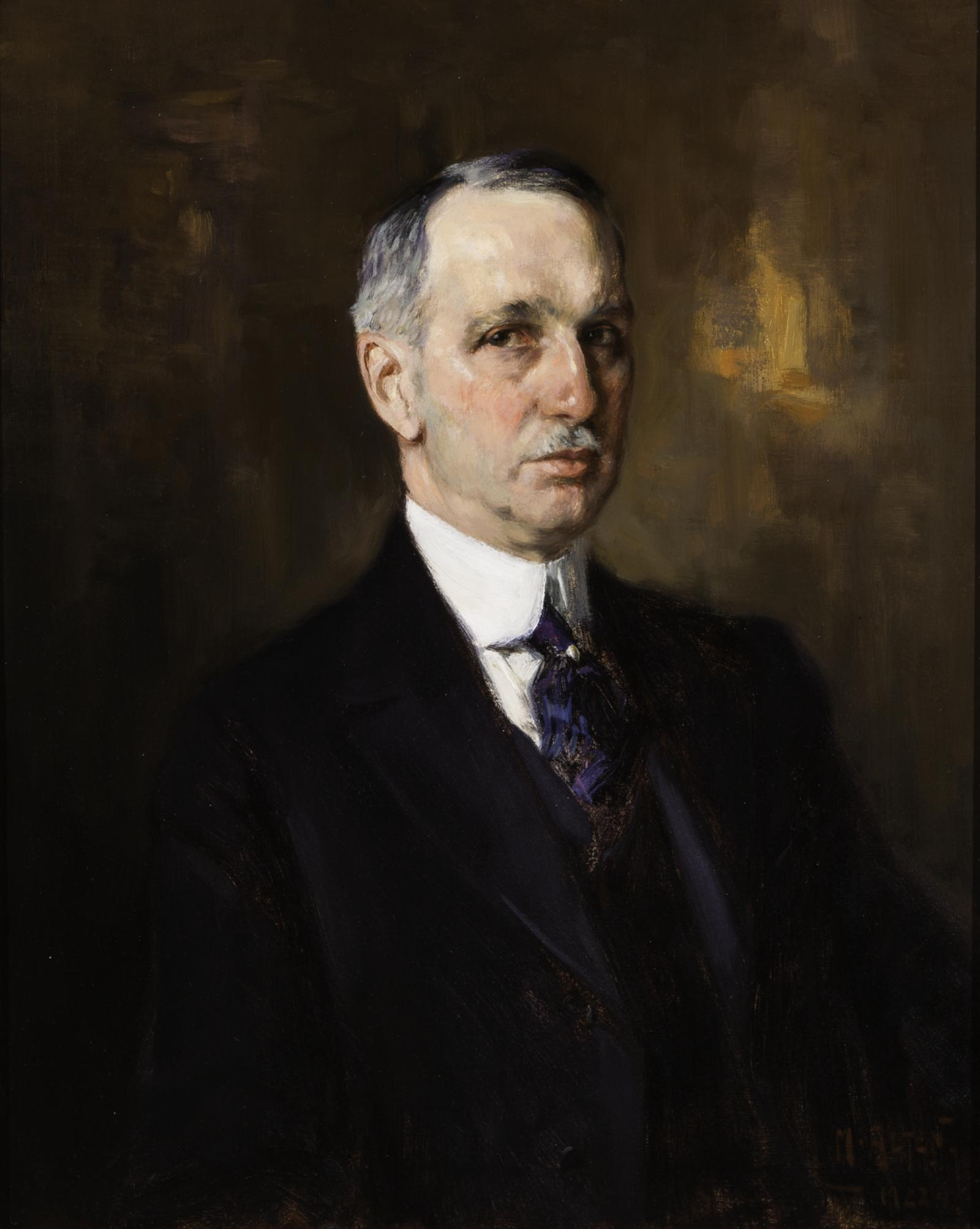 A portrait of an aging gentleman with gray hair and a mustache in a 20th century black suit, leaning to the right.