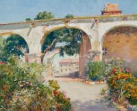 White arches with brick buildings behind them.