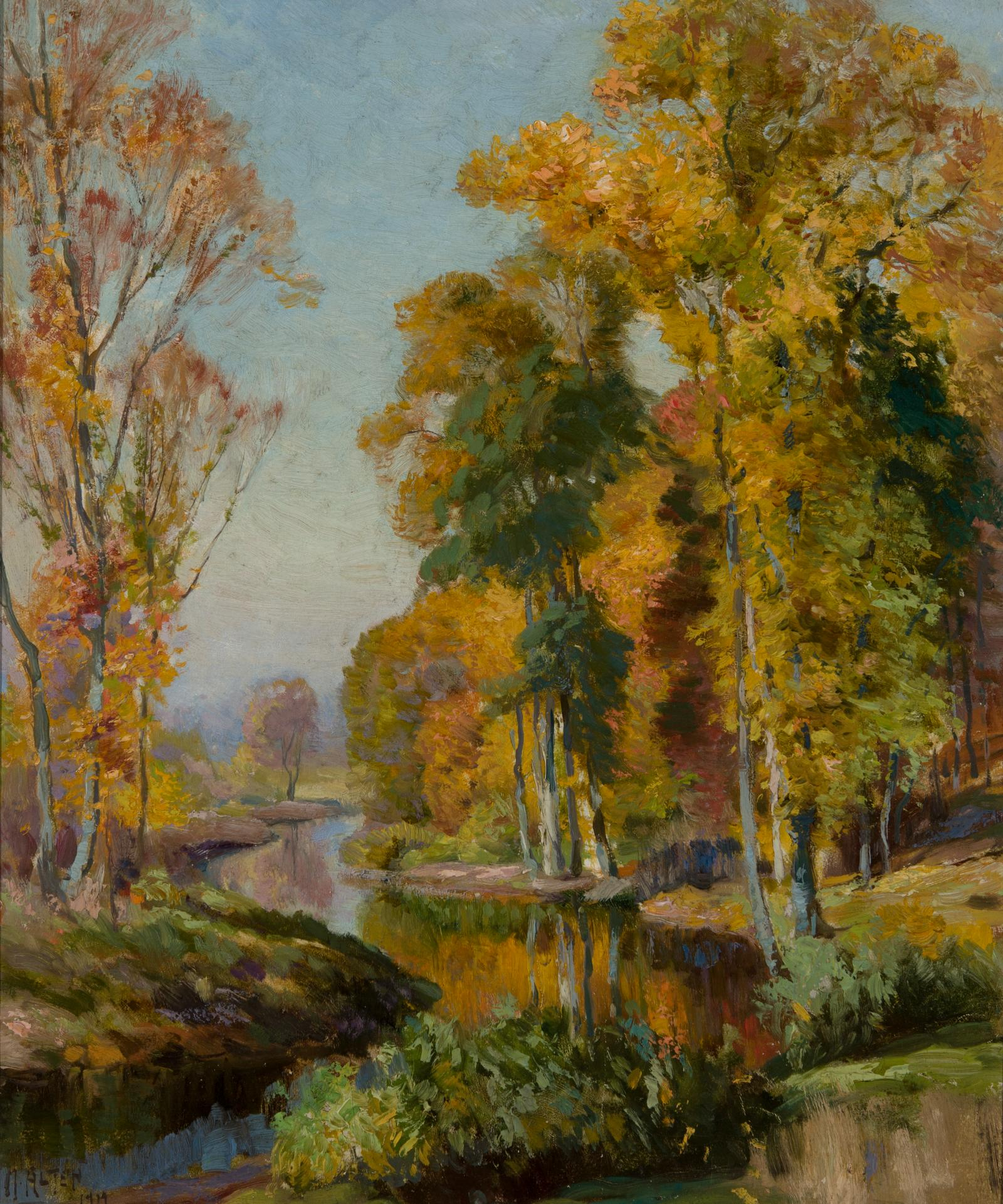 Yellow, orange, and green colored trees along the banks of a stream.