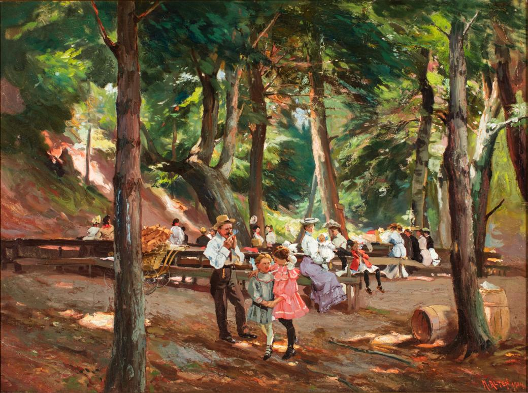 Gathering in a clearing in the woods with picnic tables.