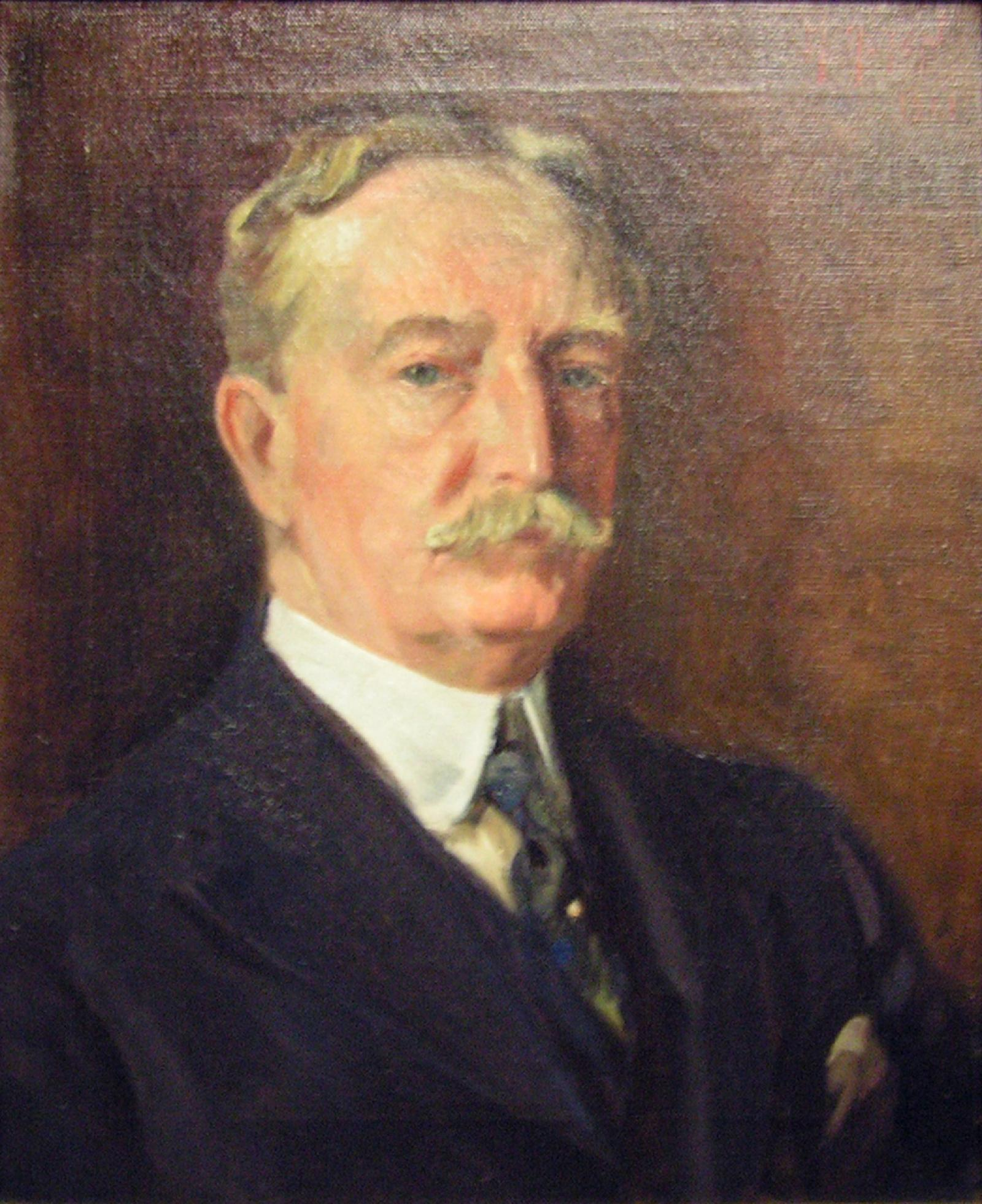 A portrait of an aging gentleman with blond hair and a blond mustache staring straight forward; body leans towards the right.