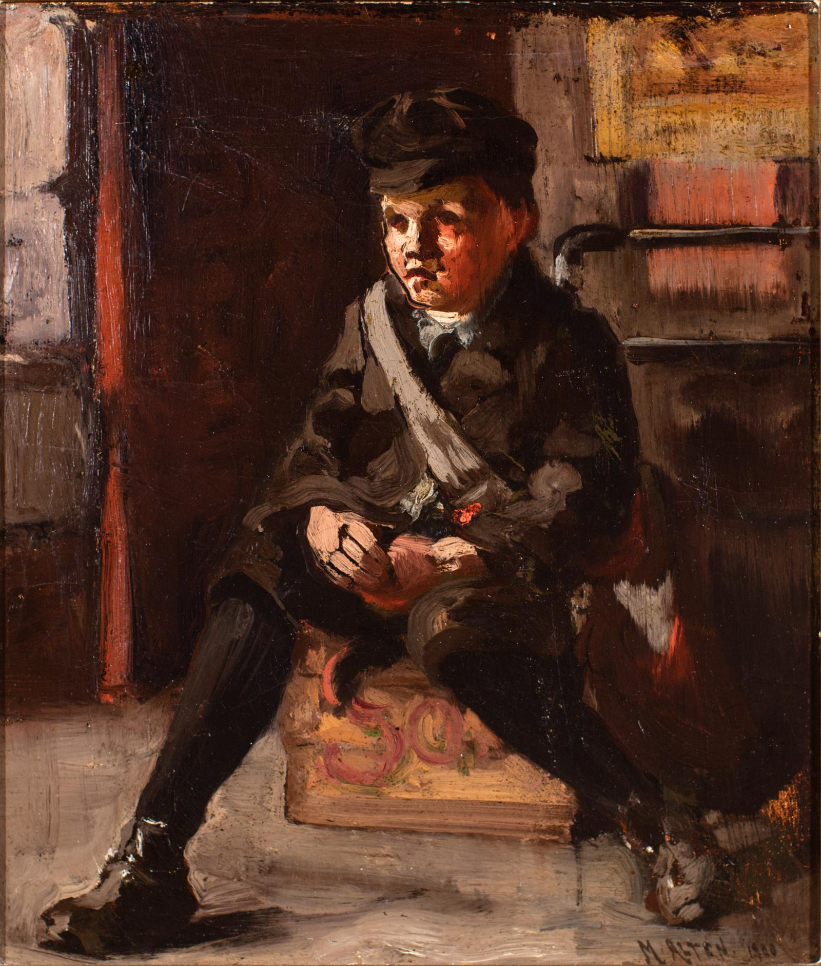 Little boy dressed in all black with a white bag slung over his shoulder sits on a crate.